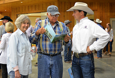 Town Creek Farm bull buyers Iris and Bill Purvis, Mississippi, discuss potential bull purchases with Clint Ladner of Town Creek Farm prior to the bull sale.